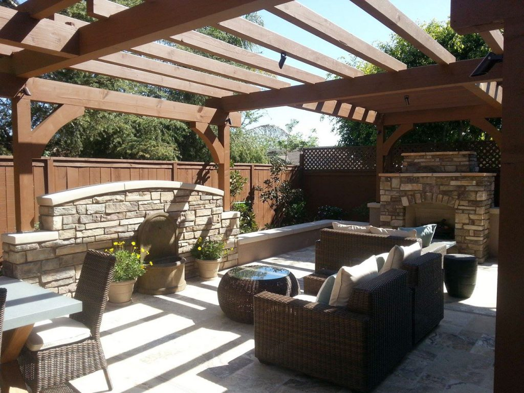 Pergola patio and outdoor fireplace construction