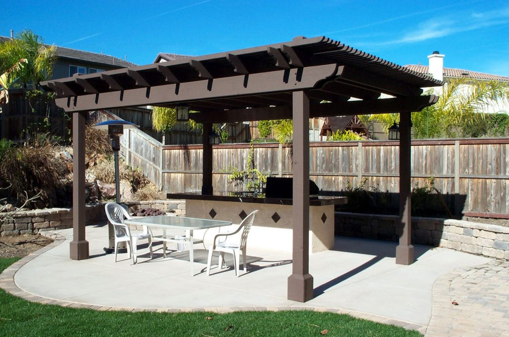 Pergola over built-in barbecue island construction
