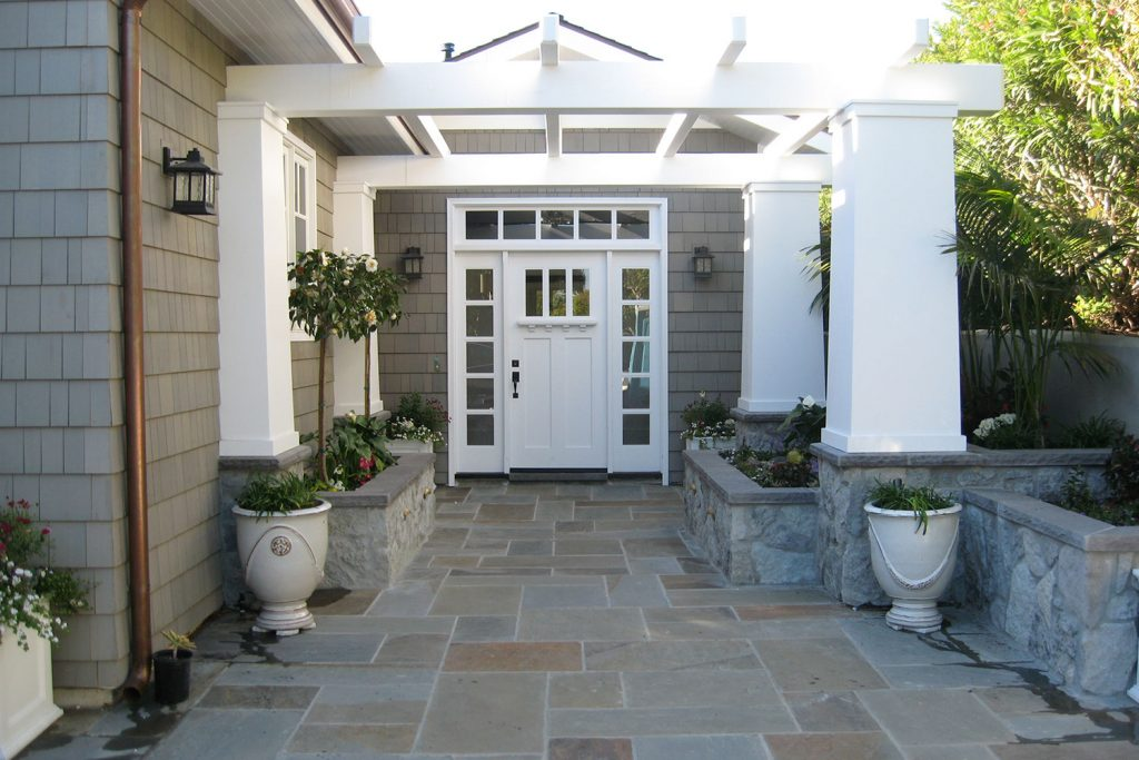 Front entry pergola and stone patio construction