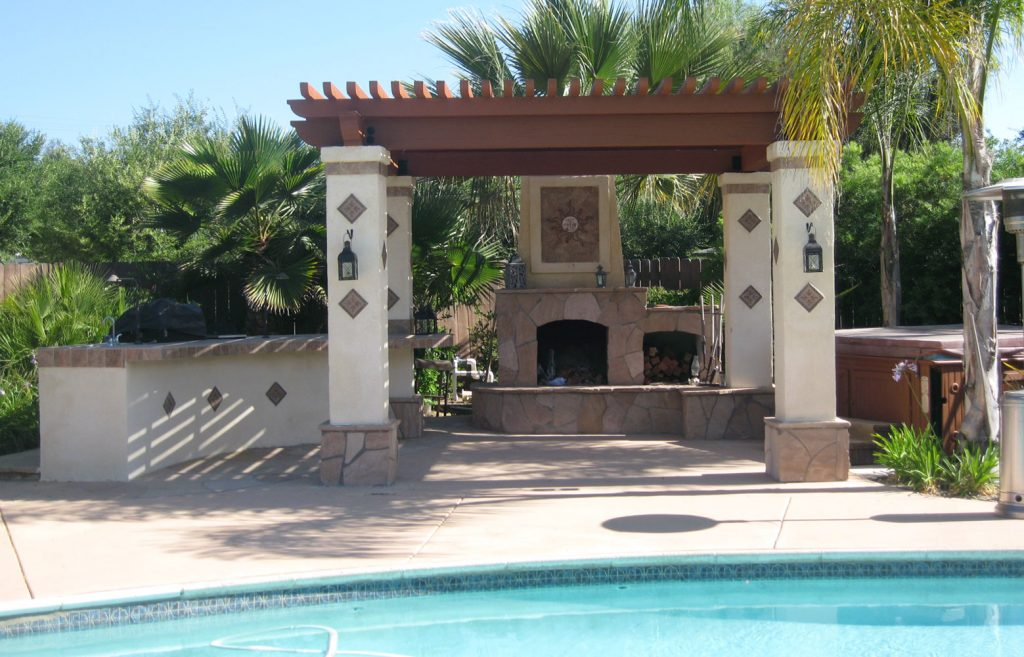 Spanish style pergola and outdoor fireplace construction