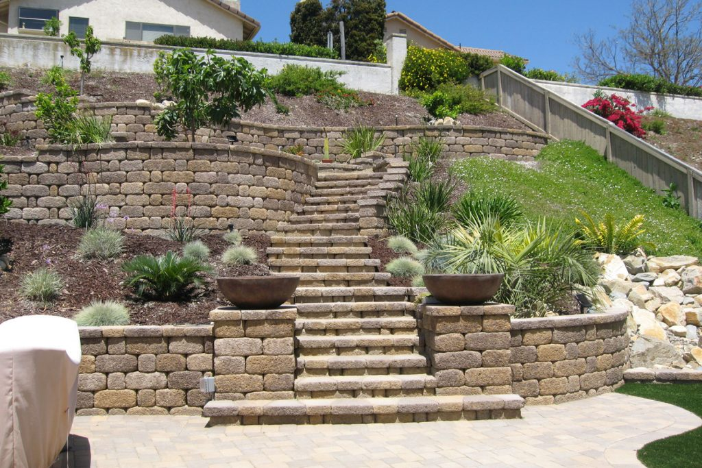 Steep back yard retaining wall and stairs contractor