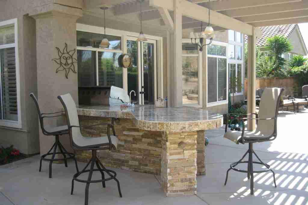 Custom outdoor kitchen island and bar