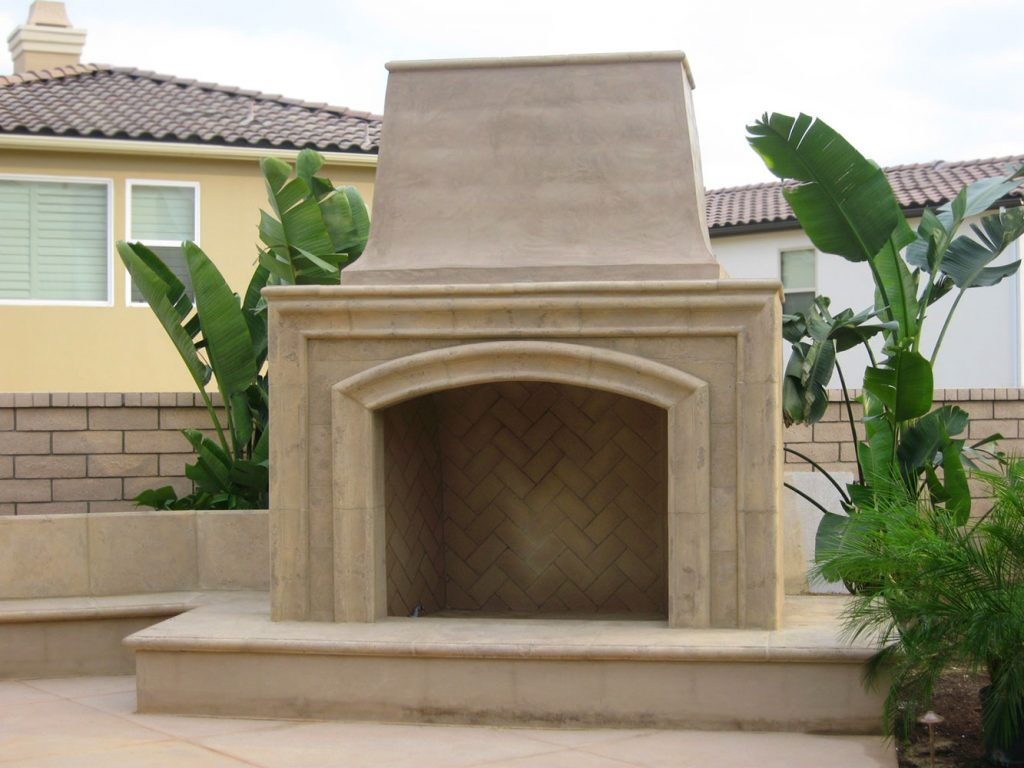 Concrete and tile outdoor fireplace construction