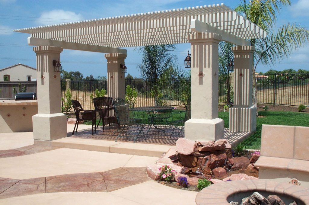 Wood and concrete pergola and back yard landscaping design