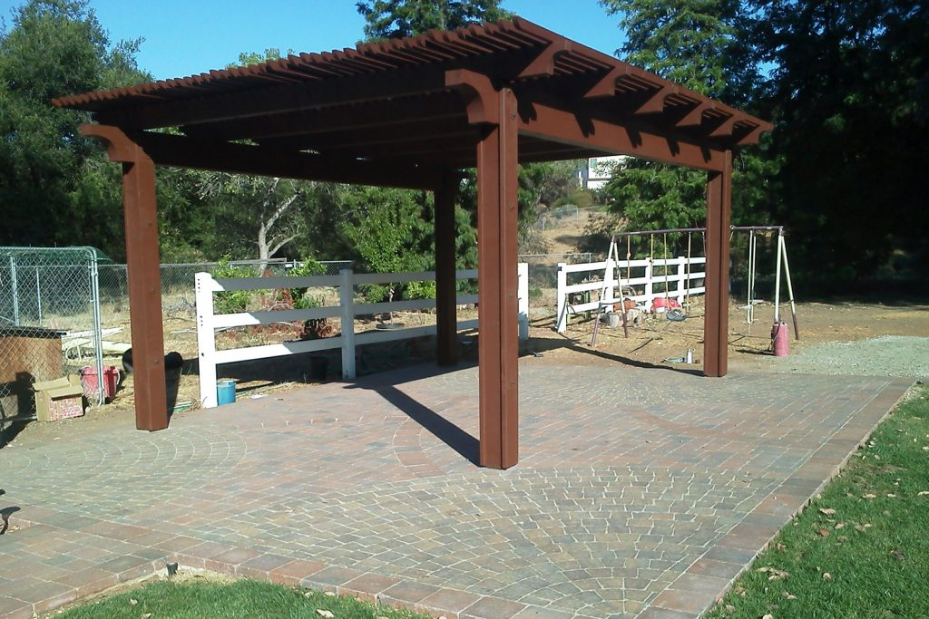 Wood pergola and brick patio design and construction