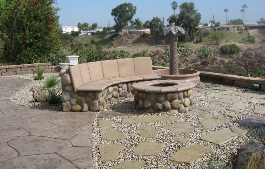 Rock outdoor seating and fire pit back yard construction