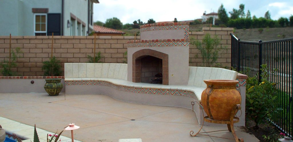 Spanish tile outdoor fireplace and seating construction company