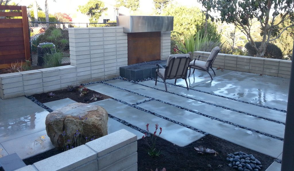 Outdoor fireplace built on modern concrete patio