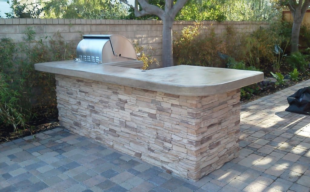 Stone patio outdoor kitchen island