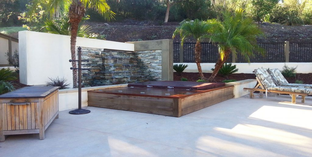 Patio design with built-in hot tub construction