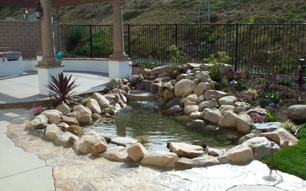Back yard waterfall and pond construction