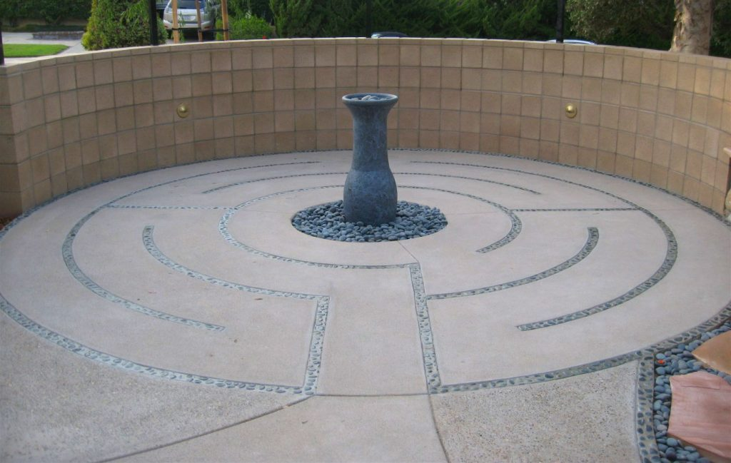 Labyrinth wall and water fountain back yard construction