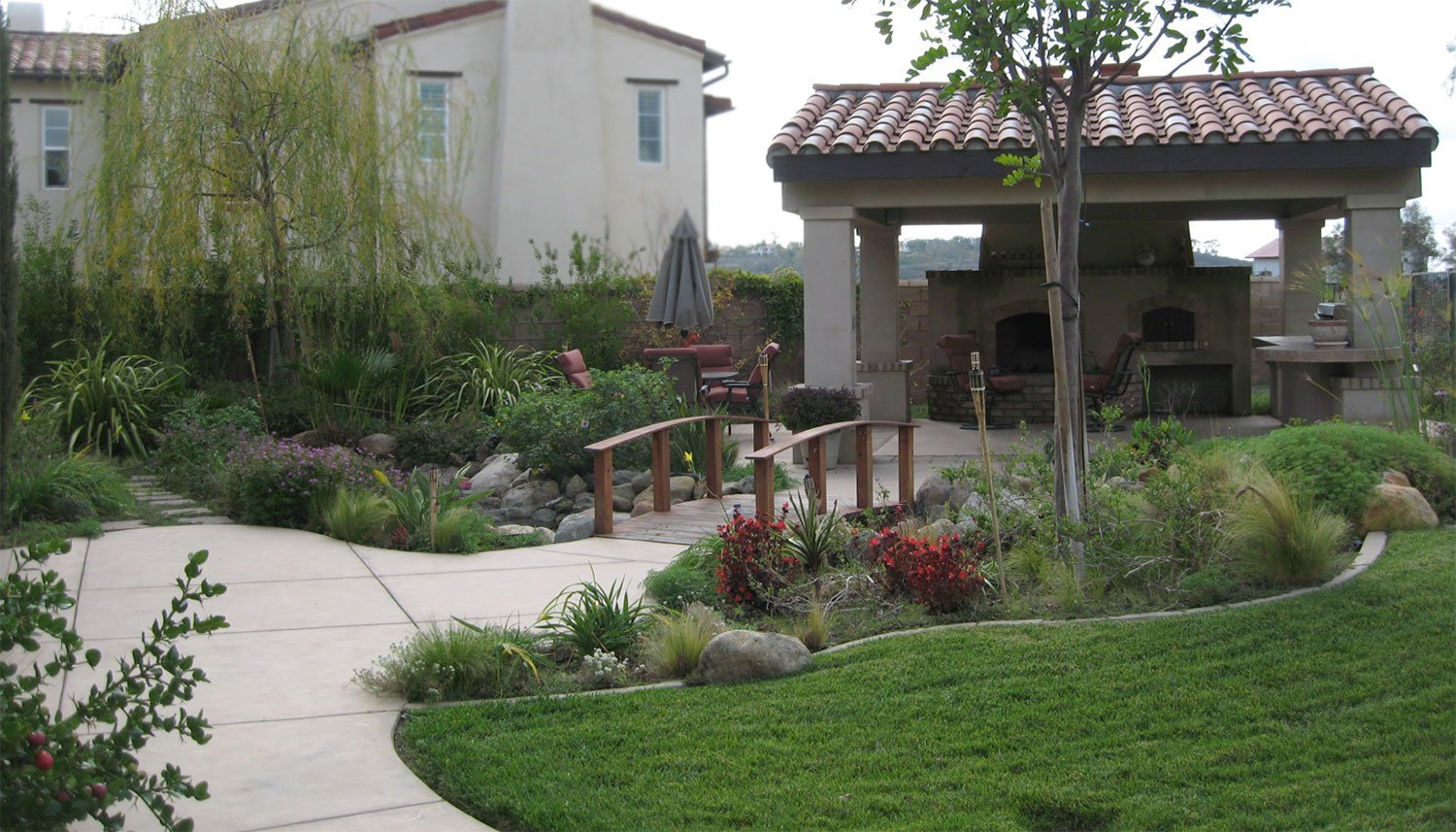 Landscaping design and construction of stream and bridge