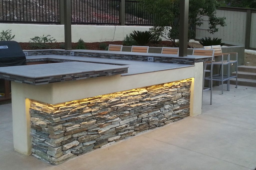 Contemporary outdoor entertainment area with lighting