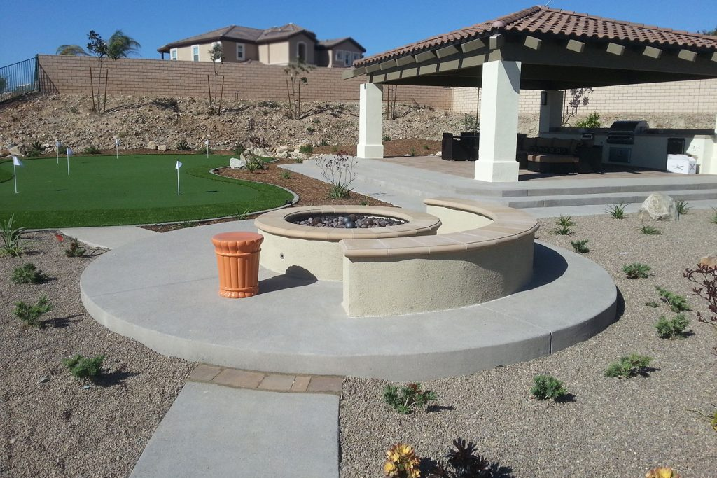Concrete patio, fire pit and built-in seating construction