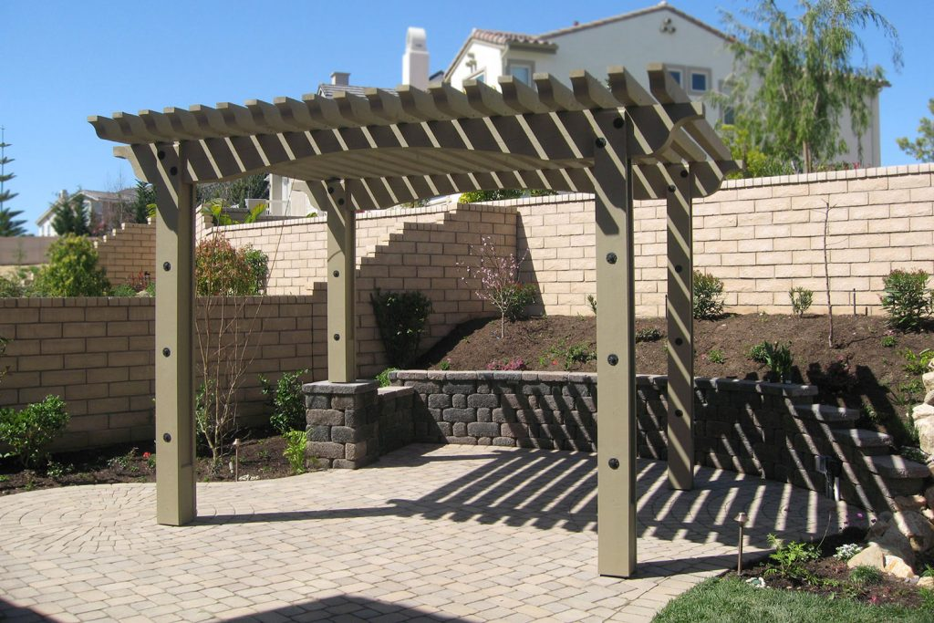 Patio shade cover over brick patio construction