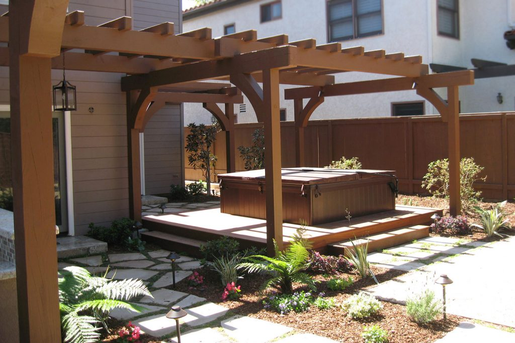 Pergola construction over built-in hot tub back yard design