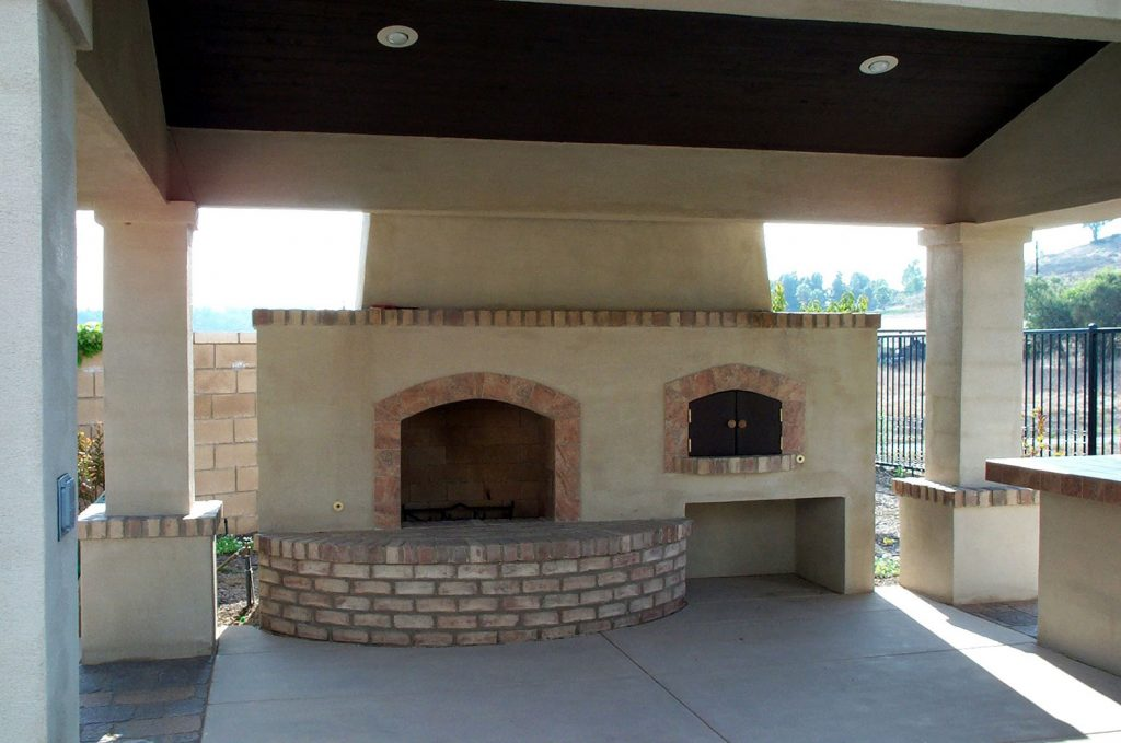 Outdoor stucco fireplace construction