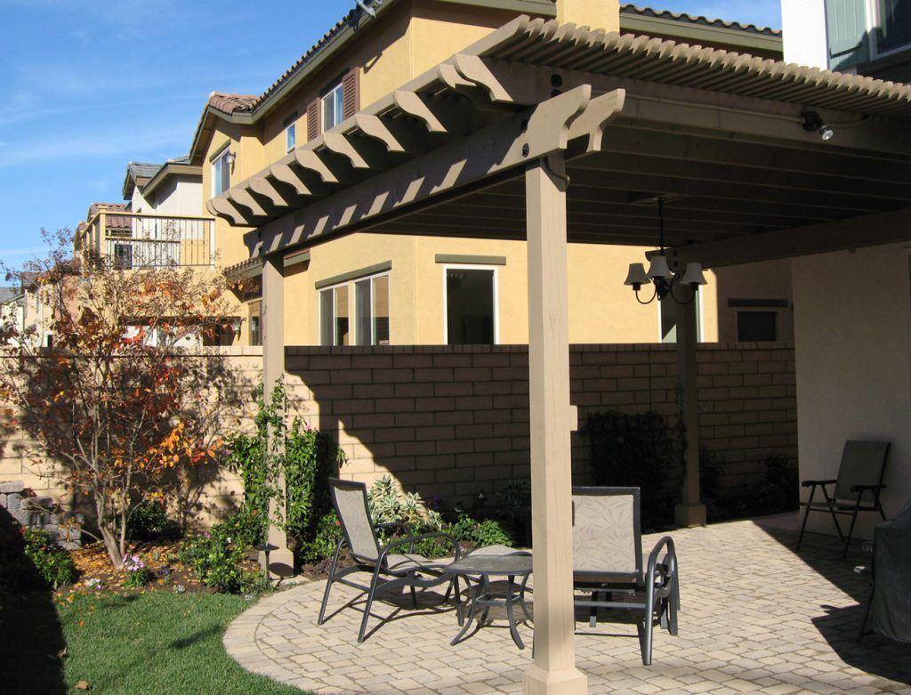 Pergola construction and brick patio installation