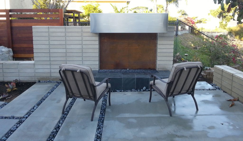 Modern outdoor fireplace and patio design and construction