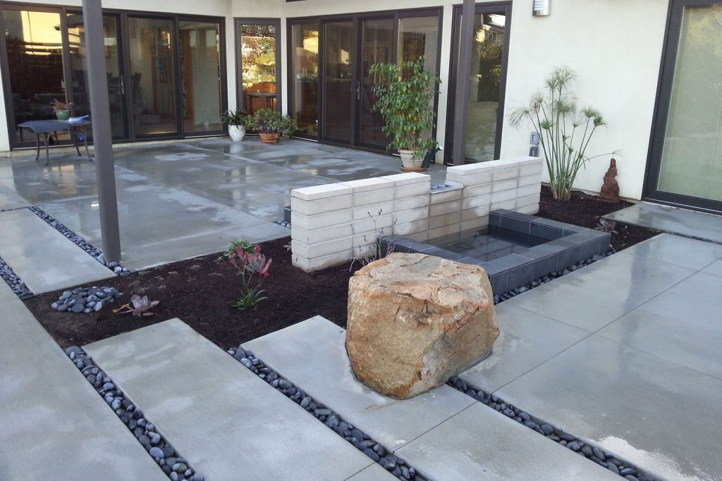 Modern concrete patio back yard landscaping contractor