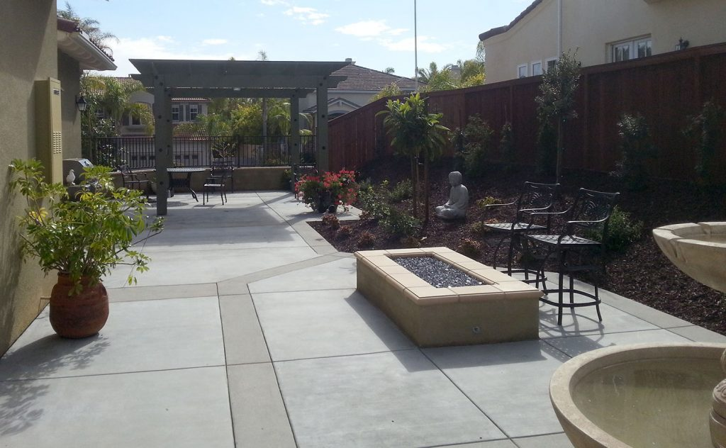 Beautiful concrete patio, fire pit and pergola construction