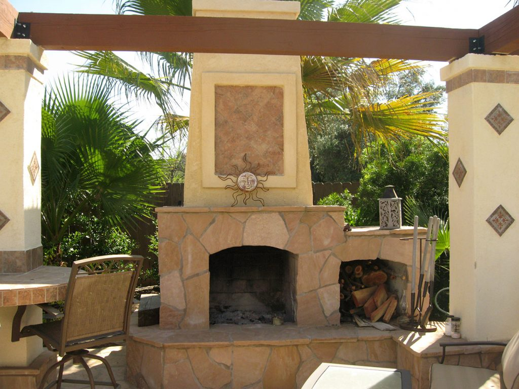 Spanish style back yard patio with fireplace construction