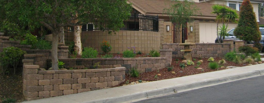 Brick retaining wall contractor and landscaping