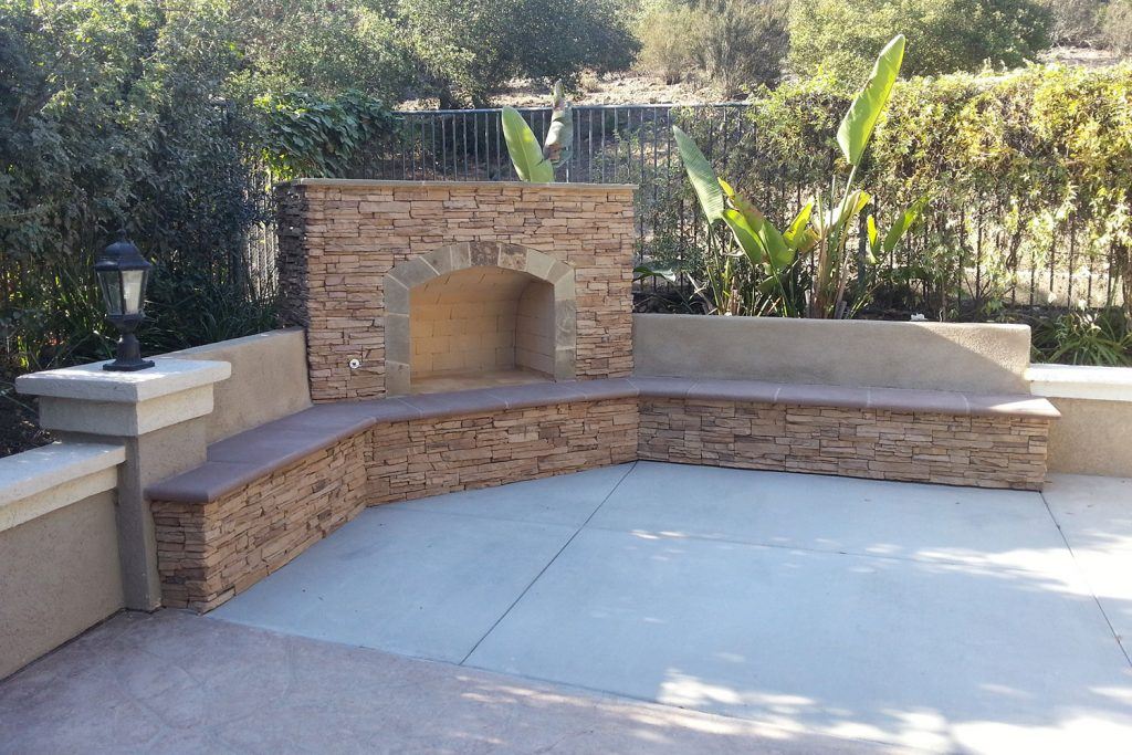 Stone fireplace construction with outdoor seating