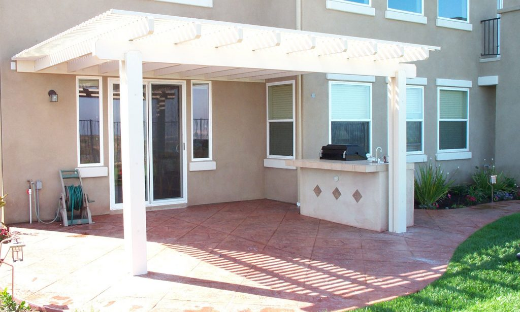 Lattice pergola and outdoor kitchen construction