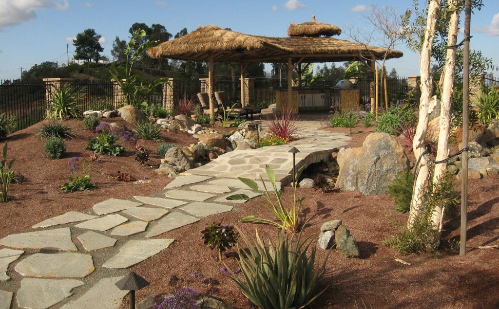 tiki hut patio design with outdoor grill island construction