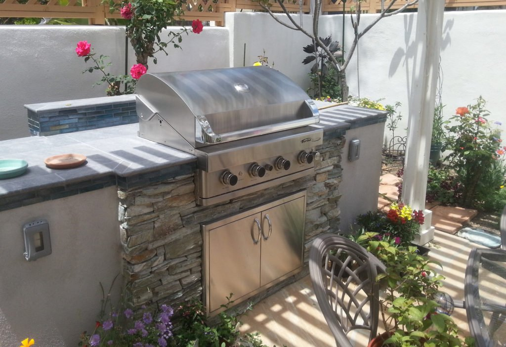 Backyard island grill constructed with counter