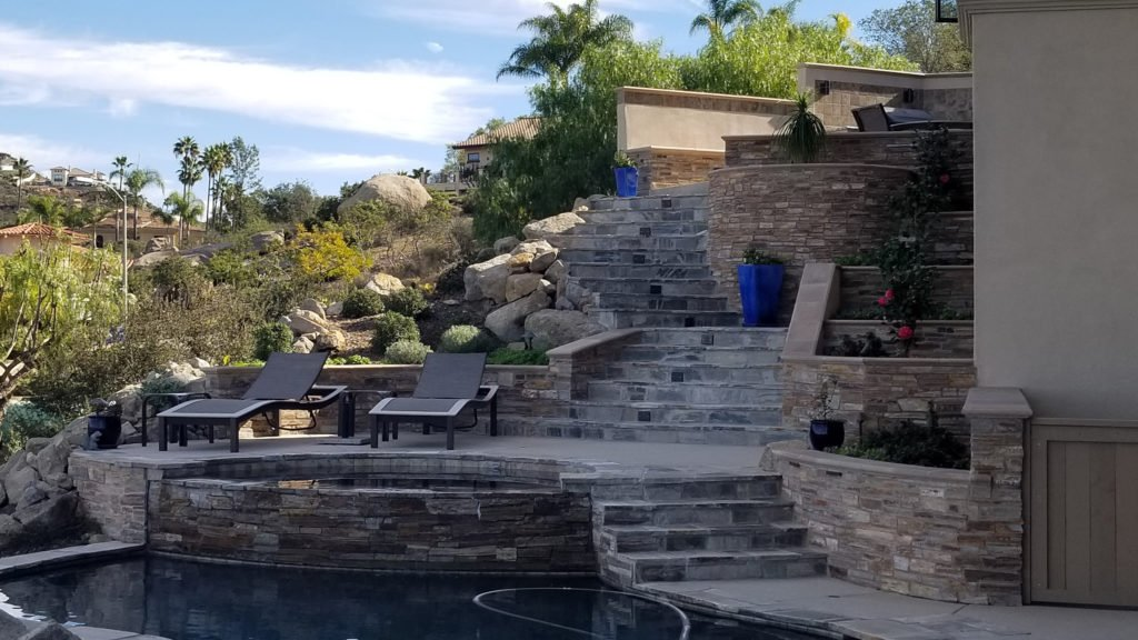 Steep backyard landscaping design and construction around pool