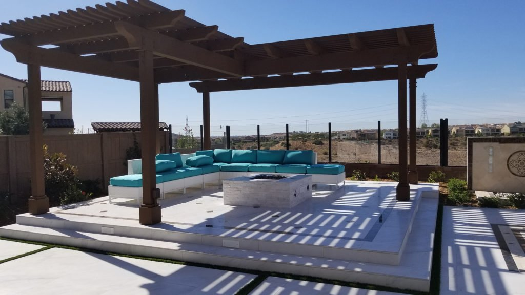 Raised concrete patio with wood pergola construction