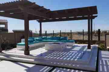 Raised concrete patio with wood pergola construction