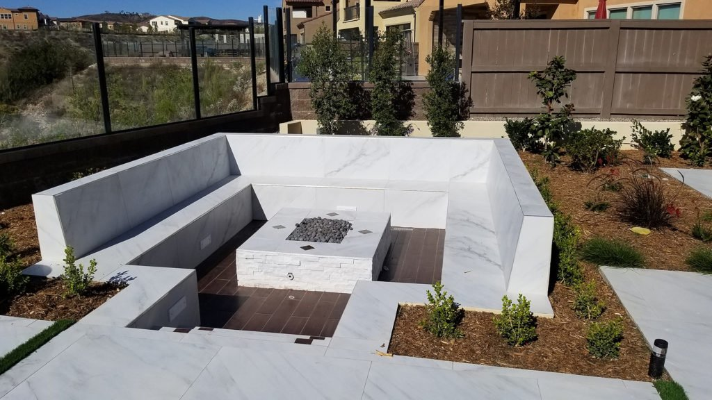 Beautiful modern marble outdoor fire table with built-in seating