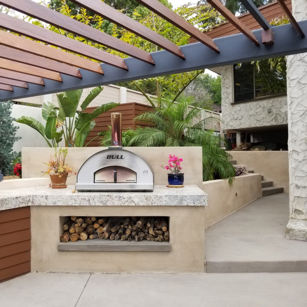 Constructed outdoor kitchen island around pizza oven