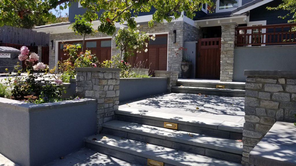 rock and concrete front yard wall and stairs construction