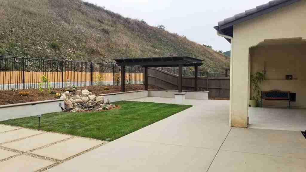 Concrete patio, waterfall and pergola construction