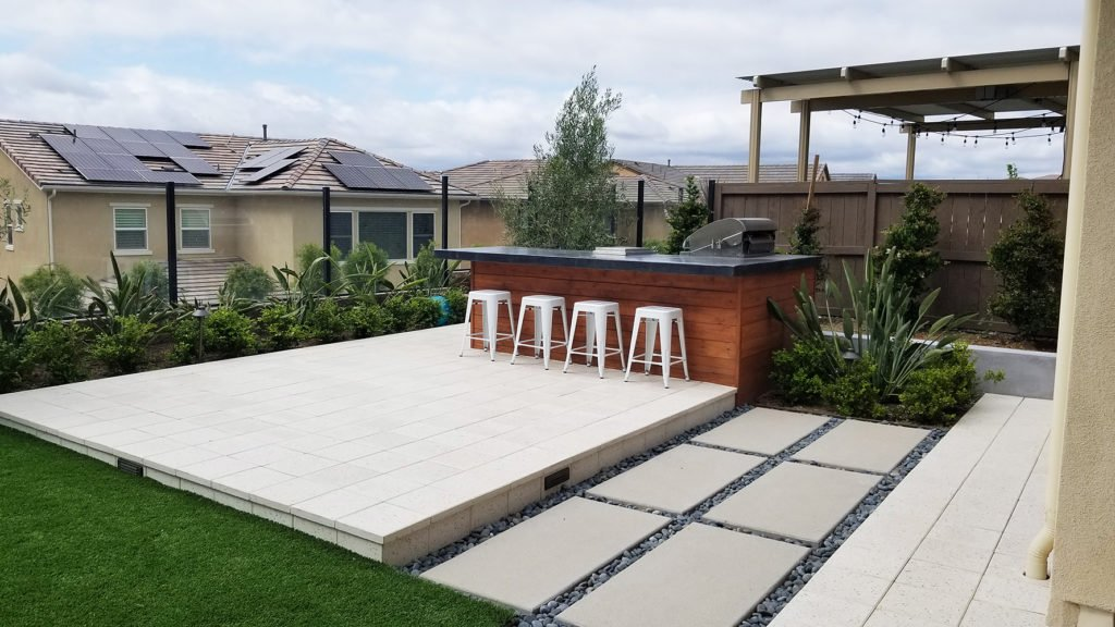 Modern outdoor bbq island and concrete patio contractor